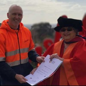 GEM College Luceille Outhred presents certificate to graduating student Shane Huddy